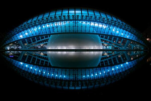 Blue Stadium with a Large Grey Sphere Inside at Night